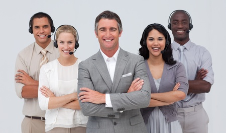 Multi-ethnic team working in a call center photo