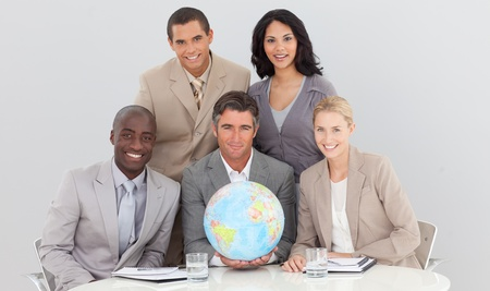 businessmeeting: Multi-ethnic business team with a terrestrial globe