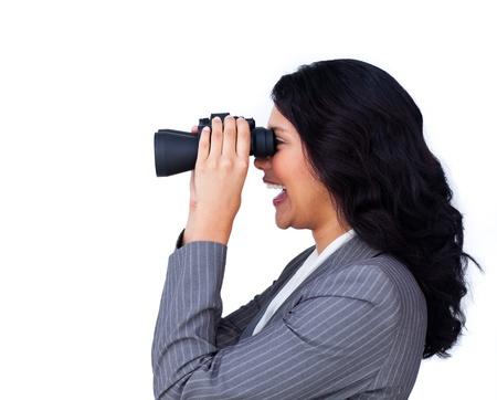 Happy ethnic businesswoman with binoculars photo