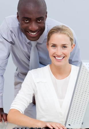 businessman working at his computer: Afro-american businessman and his colleague working at a computer