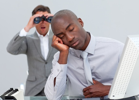 afflict: Ethnic businessman annoyed by a man looking through binoculars
