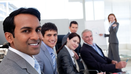 new strategy: Confident manager discussing a new strategy her team  Stock Photo