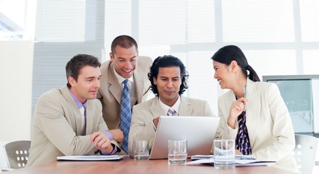 businessman talking: Smiling business partners in a meeting