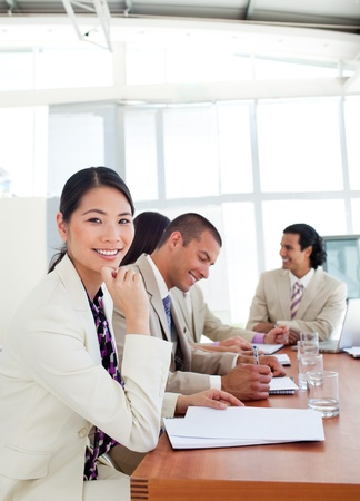 Portrait of a Asian businesswoman and her team during a presentation photo
