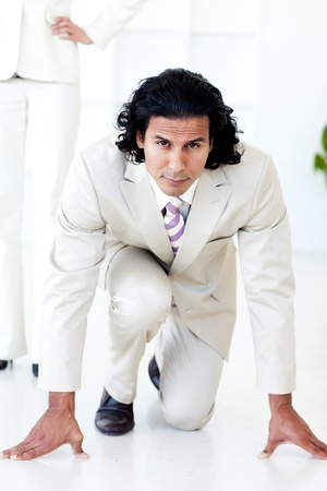 Portrait of an attractive businessman on his marks photo