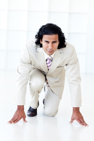 Businessman getting ready for a race photo