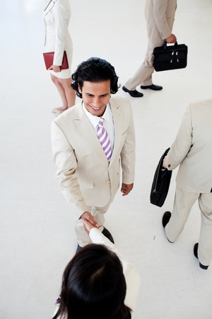 Business people shaking hands in a business building photo