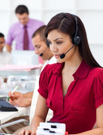 Concentrated Businesswoman using headset  photo