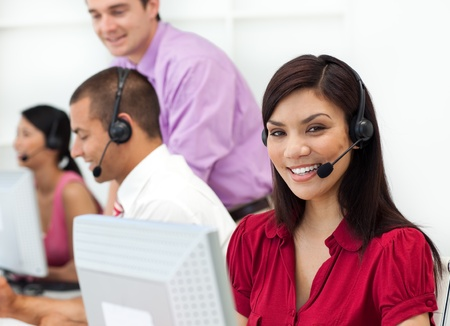 Positive Customer service representative using headset  photo