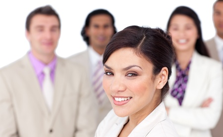 Charming female executive presenting her team photo