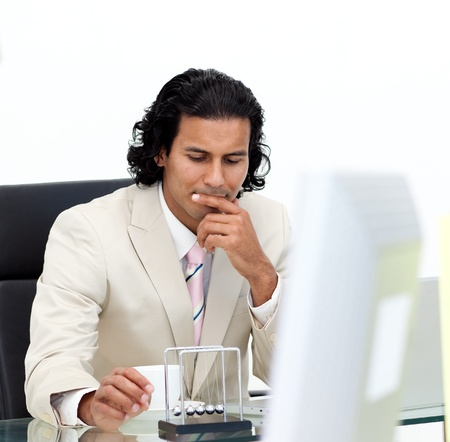 swaying: Close-up of serious businessman playing with kinetic balls Stock Photo