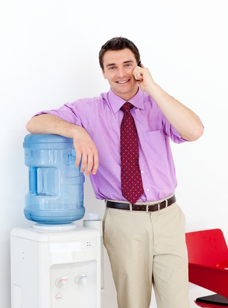 Businessman on phone by the watercooler photo