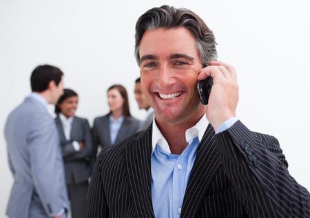 Portrait of smiling businessman on phone photo