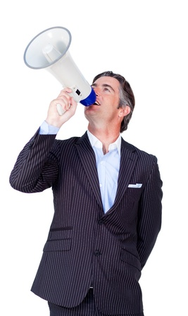 Happy businessman rowing through a megaphone photo