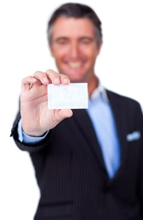 Smiling businessman holding a white card  photo
