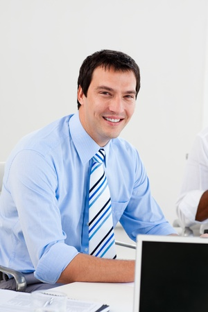 Portrait of a smiling businessman at work photo