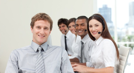 Young manager in front of his team in a call center Stock Photo - 10106782
