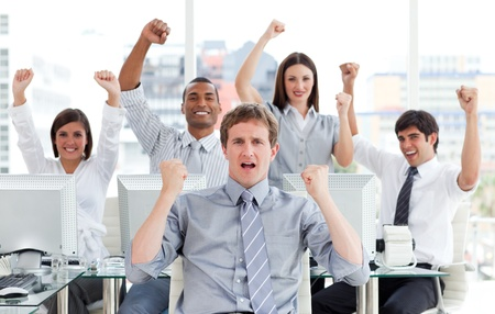 Enthusiastic business team celebrating success photo