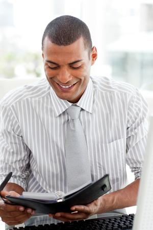Serious businessman consulting his agenda  photo