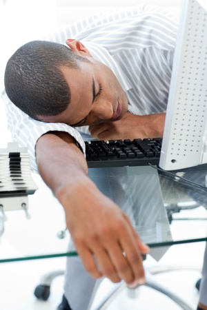 Tired businessman sleeping on his desk photo