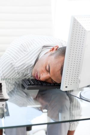 Businessman sleeping on a keyboard photo