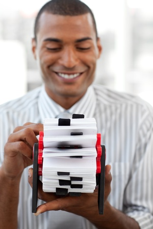 Smiling businessman holding a business card holder photo