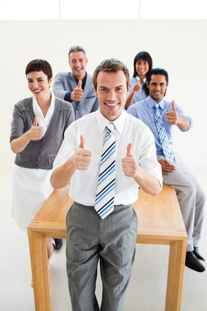 fortunate: Fortunate international business team with thumbs up Stock Photo