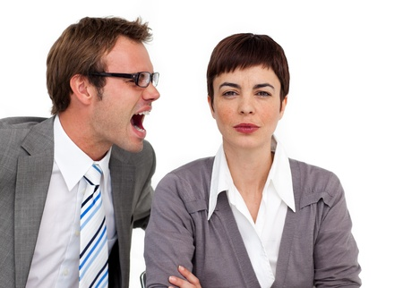 Angry businessman shouting into his colleagues ear  photo