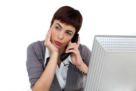 Young Businesswoman on phone at her desk  photo