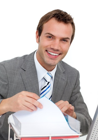 Confident young businessman studying a contract