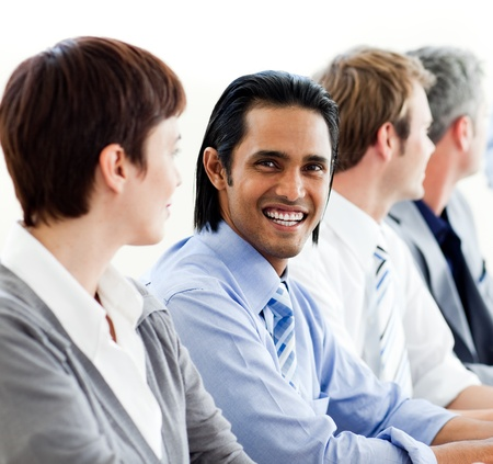 International business people sitting in a row Stock Photo - 10092084
