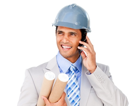 Confident architect on phone carrying blueprints photo