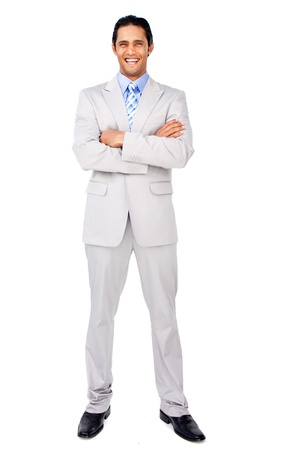 Smiling businessman with folded arms photo
