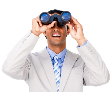 Smiling businessman using binoculars  photo