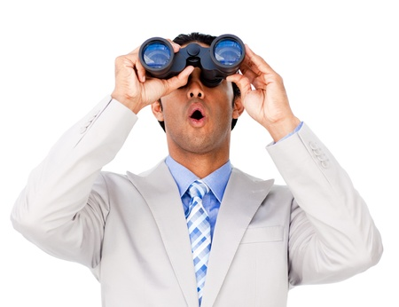 binocular: Surprised businessman looking through binoculars