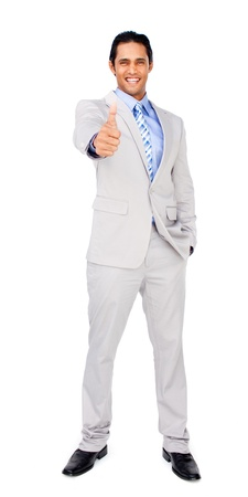 Happy businessman standing with thumb up photo