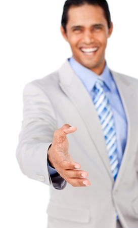 Confident businessman reaching out to shake hands photo