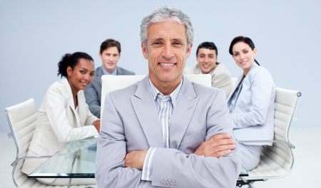 Mature businessman smiling in a meeting photo
