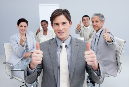 Attractive businessman celebrating a sucess with his team photo