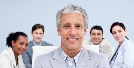 Portrait of a mature businessman smiling in a meeting photo