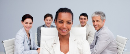 Afro-American businesswoman smiling in a meeting photo