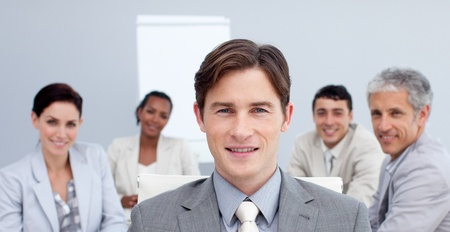 Confident businessman in a meeting photo
