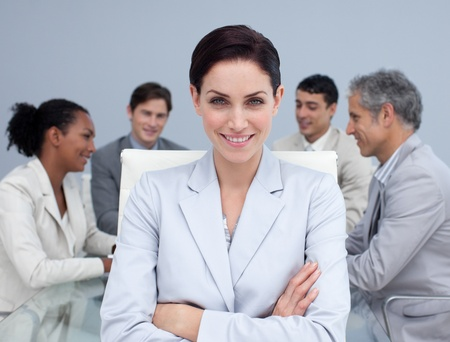 Close-up of happy businesswoman smiling in a meeting photo