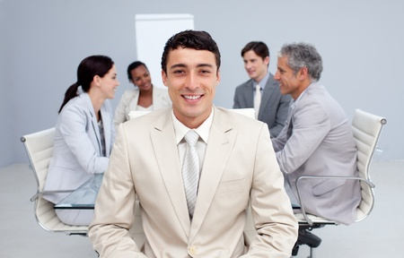 Confident businessman smiling in a meeting photo