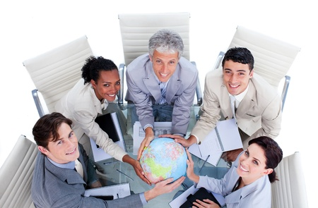 High angle of positive business people holding a terrestrial globe photo