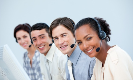Smiling business people using headset  photo