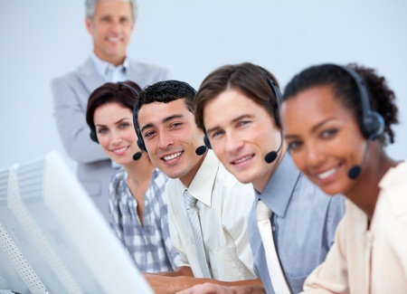 international business center: Cheerful business partners working in a call center