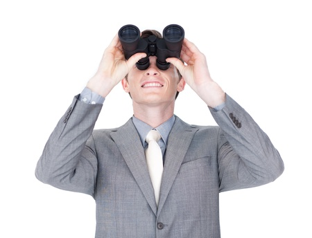 Young businessman looking up through binoculars  photo