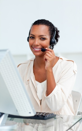 Charming businesswoman with headset on  photo