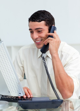 Smiling businessman talking on phone photo